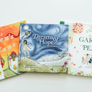 Image shows three picture books: A Lion's Mane, Dreams of Hope and The Garden of Peace