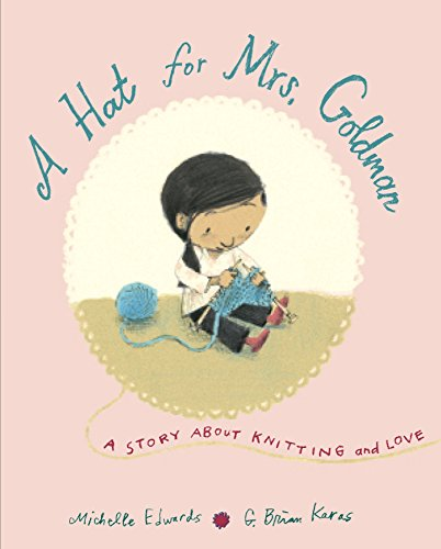 Book cover for A Hat for Mrs. Goldman shows a pink background with a young girl framed in the centre. She is sitting on the ground knitting with a ball of blue wool at the side.