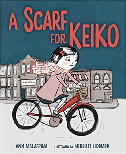 Book Cover image for A Scarf for Keiko (title in red on a vintage blue background) shows a young Japanese girl riding a red bicycle. She is wearing a red and white scarf and muted pink jacket. There are stores in the background.