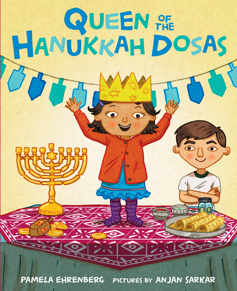 Book cover for Queen of the Hanukkah Dosas shows a young girl in a blue dress, orange cardigan and purple striped socks standing on a table with her arms in the air. She wears a gold crown. There is a menorah on the left and dosas with what looks like sambar and chutney on the right. A young boy with short brown hair watches her from the right wearing a white t-shirt and arms folded across his chest. A dreidel banner hangs in the background in shades of blue.