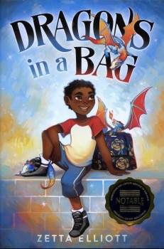 Book Cover for DRAGONS In A BAG by Zetta Elliott. Blue background with young Black boy sitting in the centre with his right leg up on the wall. He is almost leaning on a backpack on the right, with a dragon sat on it with bright orange wings. The dragon's tail appears under the boy's right foot.